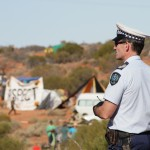 Police Officer looking out over the camp