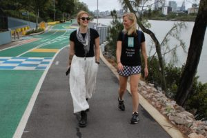 Eleanor Goldfield and Casey Davidson walking in Brisbane